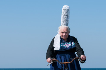 breton headdress under a blue sky
