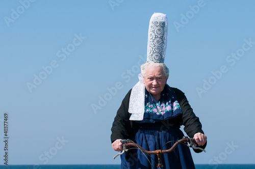 breton headdress under a blue sky