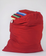 Red Laundry Bag with Folded Colorful Shirts on Top