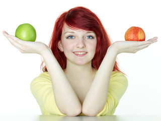 Pretty girl holding one fresh, green and one crumpled apple