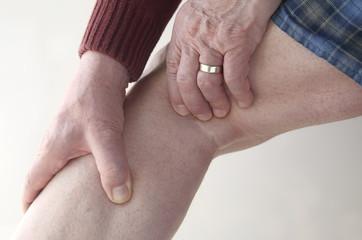 man checks pain in his leg