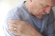 Leinwandbild Motiv shoulder pain in a senior man