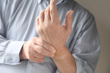 man has pain in wrist