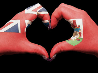 Heart and love gesture by hands colored in bermuda flag for tour