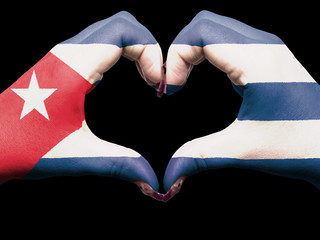 Heart and love gesture by hands colored in cuba flag for tourism