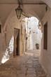 Leinwandbild Motiv Alleyway. Cisternino. Puglia. Italy.