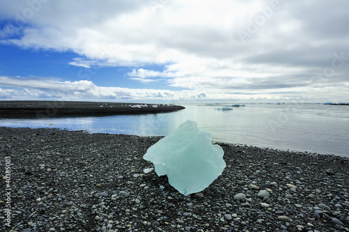 little iceberg on the sand beach