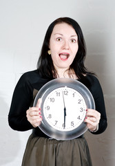 Woman showing on the clock