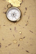 Old style compass and paper background