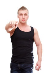 Man pointing by hand in black t-shirt. Selective focus. On white