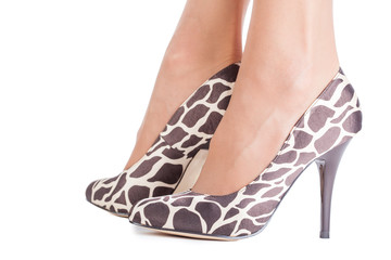 Giraffe print shoes on lady isolated on white
