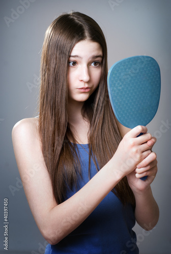 Teen girl with a mirror