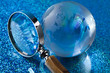 Travelling, magnifying glass and globe