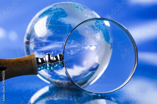 Magnifying glass and globe