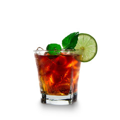 cola with lime and ice cubes over white