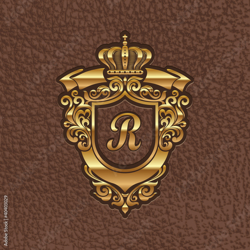 Golden royal coat of arms embossing on a leather