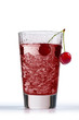 cherry juice in glass with ice cube, on white background
