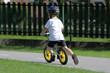 Baby boy on traffic playground for childs with crash helmet