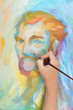 man hand painting multicolored abstract portrait of male