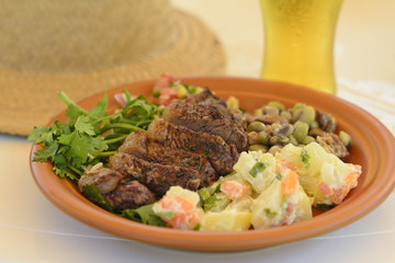 BBQ Beef -Grilled beef with potato salad, salsa & black eyed pea