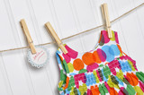 Polka Dot Baby Dress on a Clothesline with Handwritten Sale Sign