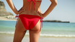 Sexy woman body in red bikini on the beach, steadicam shot