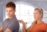 Angry girlfriend poking boyfriend poster