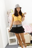Pretty girl posing in mini skirt smiling
