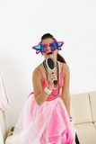 Young girl with funny glasses singing