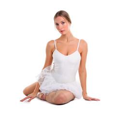 Portrait of a ballerina relaxing on the floor