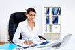 Young woman in business wear in office