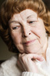 pensive elderly woman