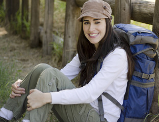 Young beautiful woman taking a break on a hiking trip