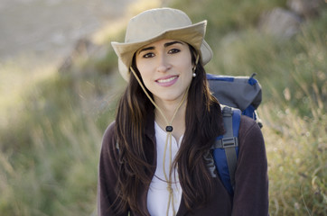 Portrait of a young woman on a hiking trip