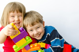 Two happy children play with blocks - 40428638