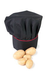 Chef's hat and potatoes on white