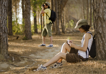 Young couple taking a break on a hiking trip
