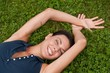 Enjoying life - woman lying in grass