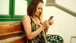 Attractive young woman using smartphone, steadicam shot