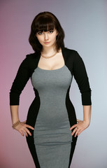 The beautiful girl in a black-gray dress