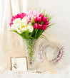 Beautiful spring flowers in a glass vase with banner add