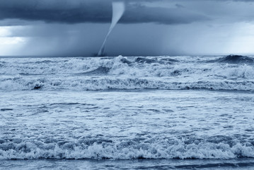 twister at horizon on the stormy sea