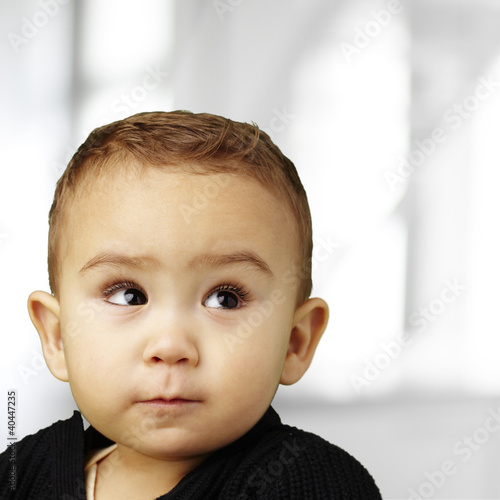 portrait of adorable baby looking up indoor