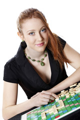 Young woman playing board game