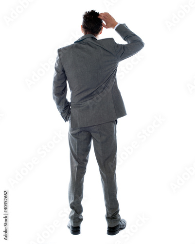 Back-pose of a corporate person thinking