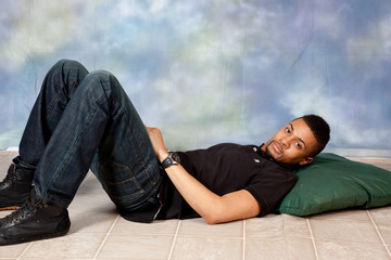 Handsome black man laying on floor