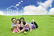 Young Asian Family with a dream house on the field