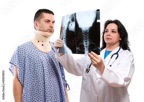 Caucasian female doctor looking at neck x-ray isolated