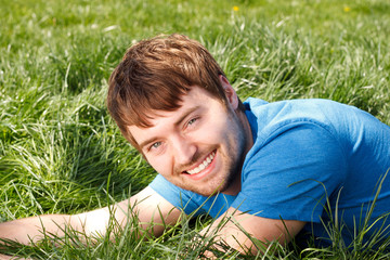 Attractive Young Man Laying In Grass