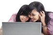 Mother and daughter surfing the net
